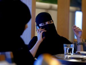 A woman speaks on a mobile phone in Saudi Arabia